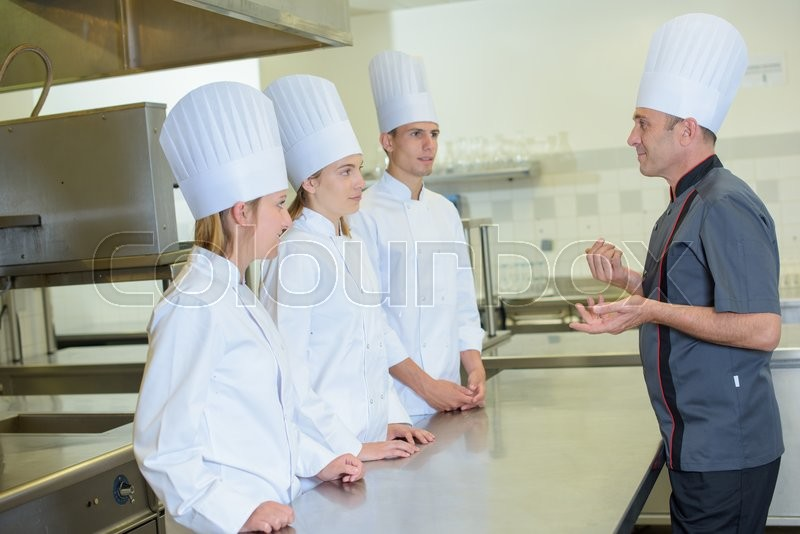 Stock image of 'Chef giving out explanation'