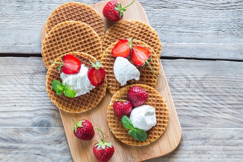 Stock image of 'Belgian waffles with ricotta and strawberries'