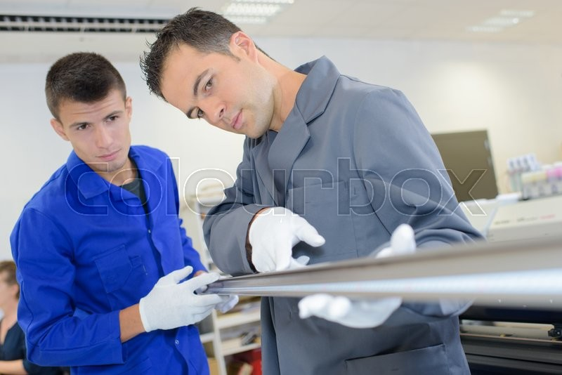 Stock image of 'Factory workers'
