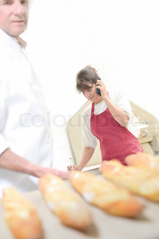 Stock image of 'Baguettes, baker and shop assistant'