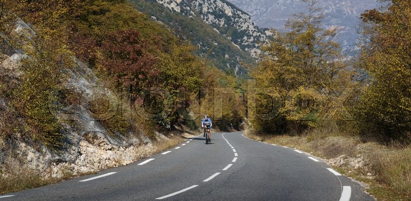 Stock image of 'MONACO - OCTOBER  31, 2014: Cyclists on a mountain road in the Alpes-Maritimes'