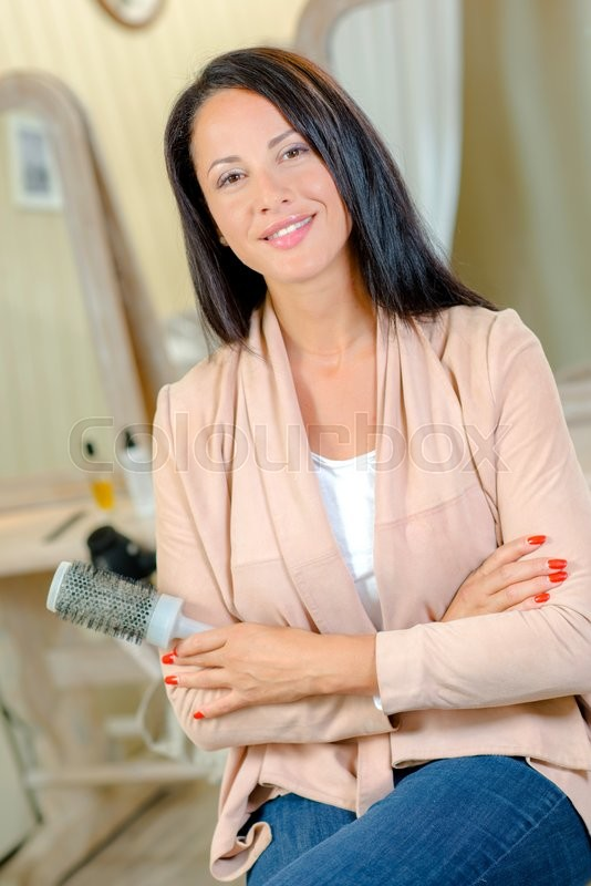 Stock image of 'Hairdresser in her boutique'