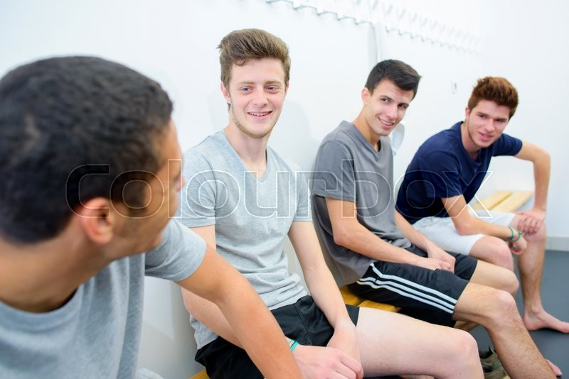 Stock image of 'Men in the changing room'