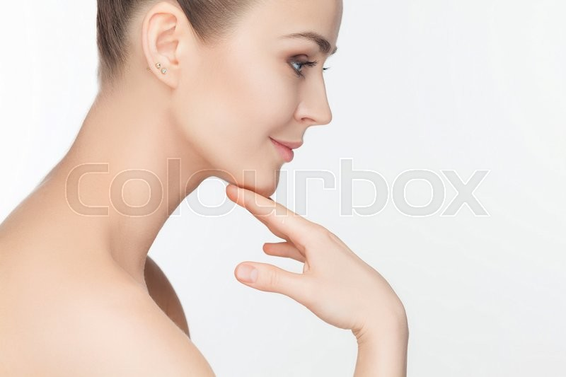 Stock image of 'The beautiful female face. The perfect and clean skin of face on white'