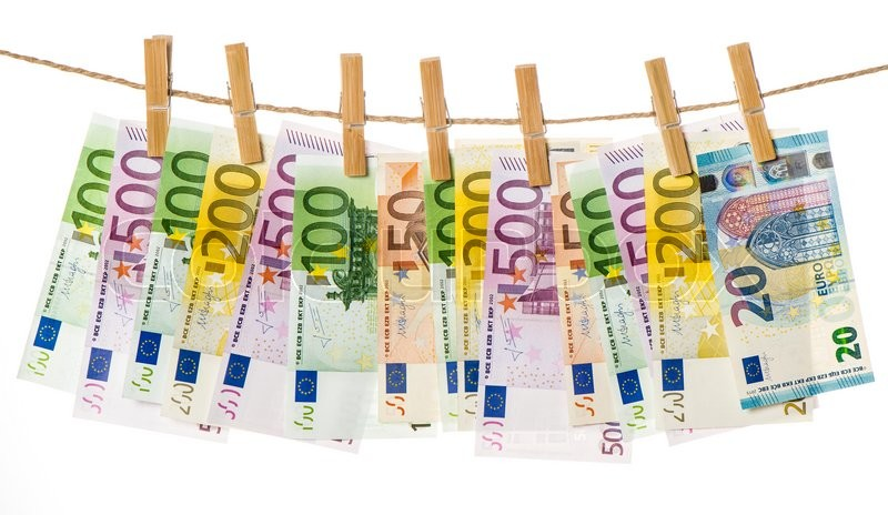 Stock image of 'Money background. Euro banknotes hanging a rope with clothes pins'