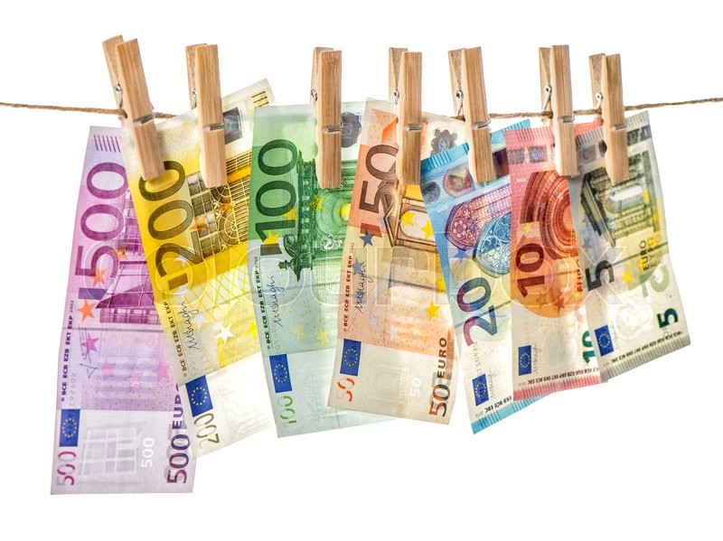 Stock image of 'Money background. Euro banknotes hanging a rope with clothes pins. Selective focus'