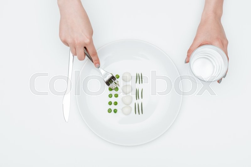 Stock image of 'Top view of woman eating healthy food and drinking water over white background'
