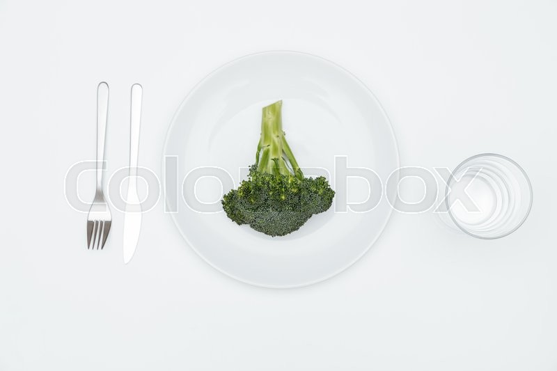 Stock image of 'Top view of broccoli on the plate over white background'
