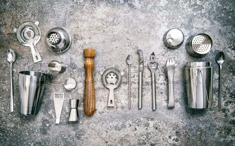 Stock image of 'Bar tools for making cocktail. Shaker, jigger, strainer, spoon. Food and beverages. Vintage style toned picture'