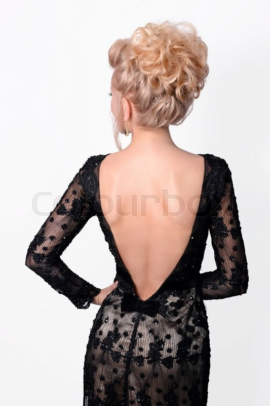 Stock image of 'Beautiful lady in elegant black evening dress. Fashion photo.'