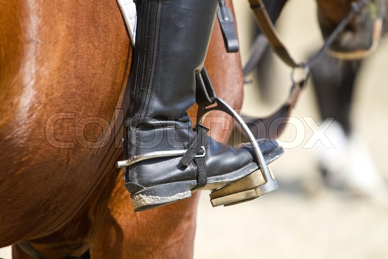 Stock image of 'Jockey riding boot in the stirrup'