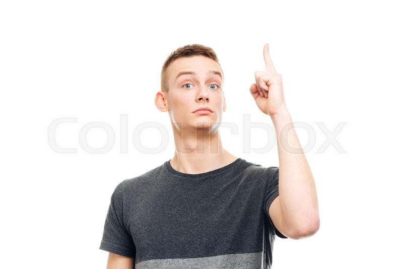 Stock image of 'Young man pointing finger up isolated on a white background'