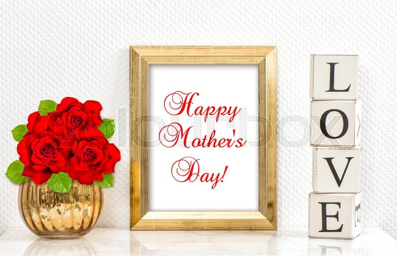 Stock image of 'Golden frame and red roses. Mock up with space for your picture. Sample text Happy Mothers Day!'