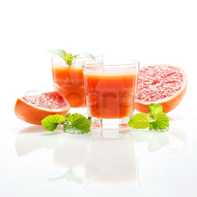 Stock image of 'Grapefruit juice with fruits and mint leaves. High key morning light'