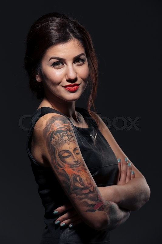 Stock image of 'Portrait of attractive smiling young woman with tattoo on her hands'