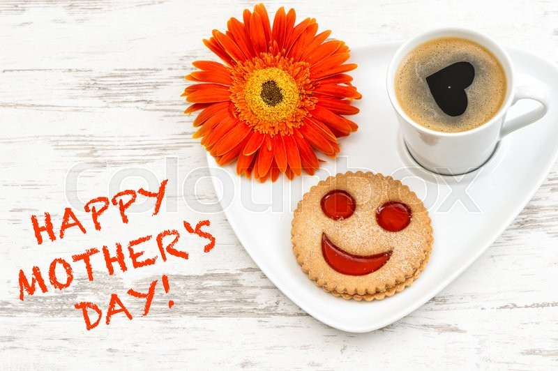 Stock image of 'Black coffee with smiled cookie. Heart, love, flower. Happy Mothers Day!'