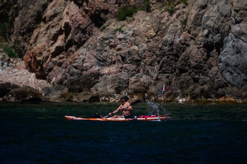 Editorial image of 'Palamos, Catalonia, may 2016:Man float in a canoe'