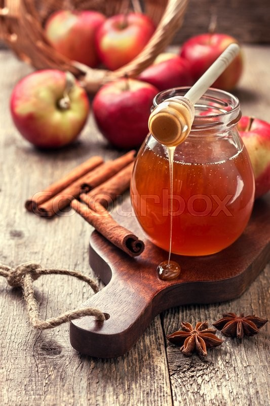 Stock image of 'honey spoon,  jar of honey, apples and cinnamon on a wooden background in a rustic style (toning)'