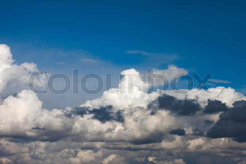 Stock image of 'Whte and black clouds on background of deep blue sky'