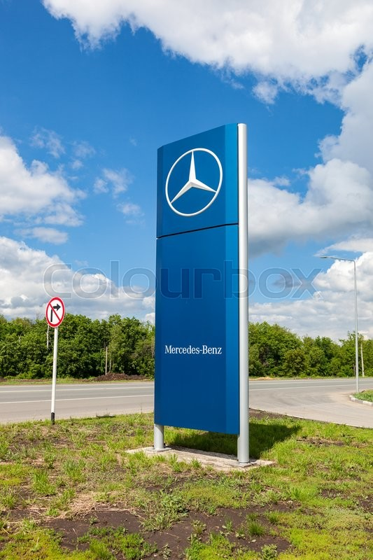 Editorial image of 'SAMARA, RUSSIA - MAY 22, 2016: Official dealership sign of Mercedes-Benz in summer sunny day. Mercedes-Benz is a German automotive manufacturer'