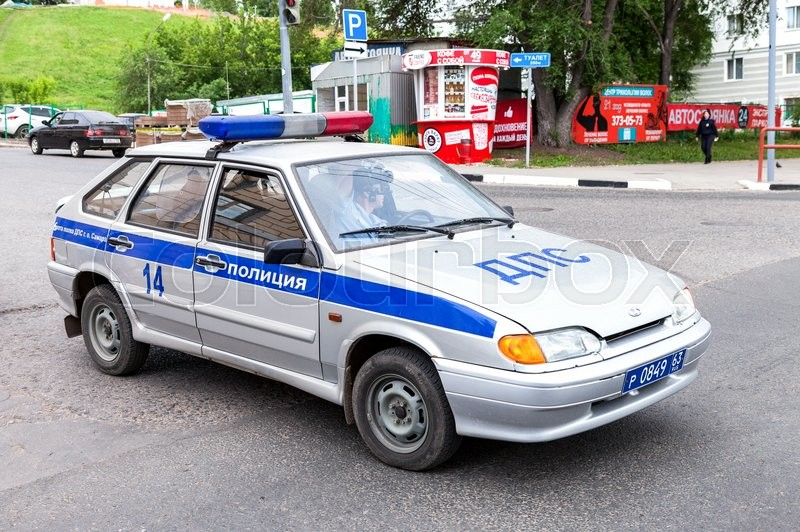 Editorial image of 'SAMARA, RUSSIA - JUNE 4, 2016: Russian police patrol car of the State Automobile Inspectorate parked on the city street in summer day'