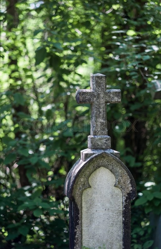Stock image of 'a stone cross in a cemetery. peace and memory of the deceased.'