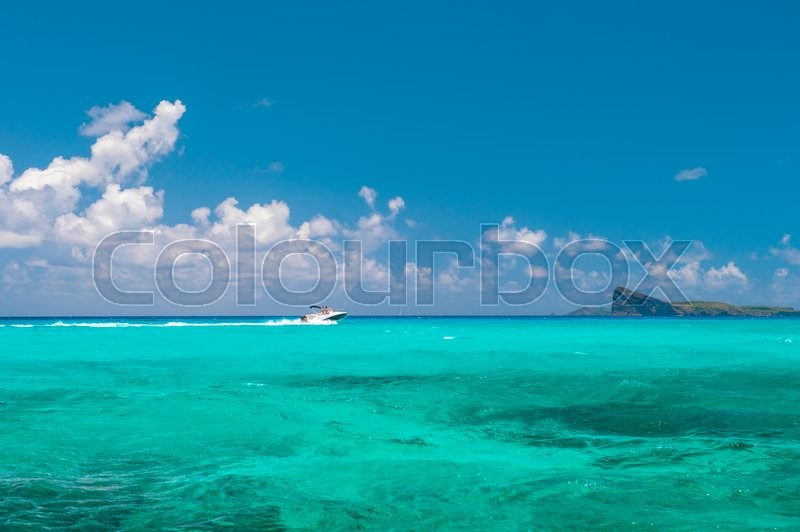 Stock image of 'Turquoise sea water and perfect blue sky. Travel background. Nature landscape'