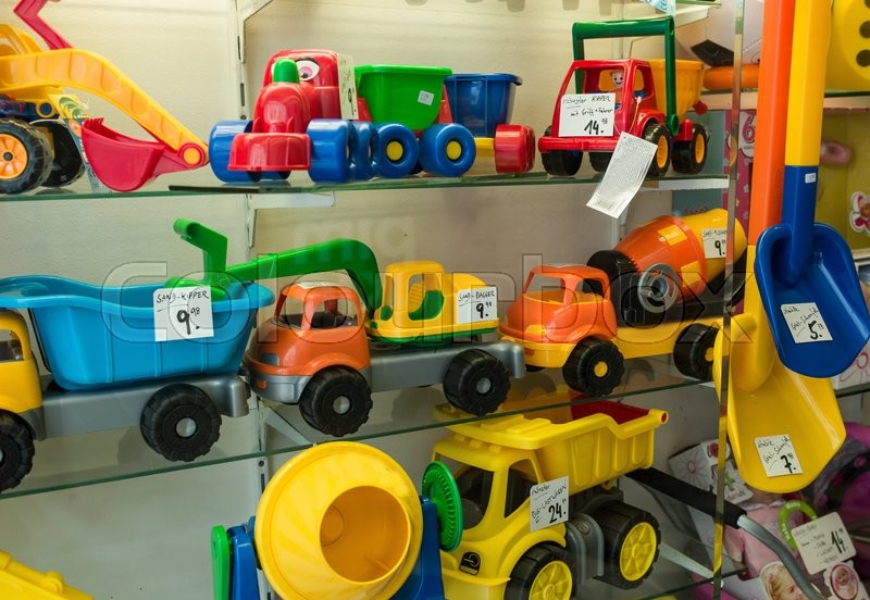 Stock image of 'trucks, excavators and blender in a showcase for children's toys'