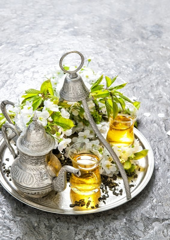 Stock image of 'Tea glasses and pot. Oriental holidays decoration. Silver tea dishes. Herbal tea'