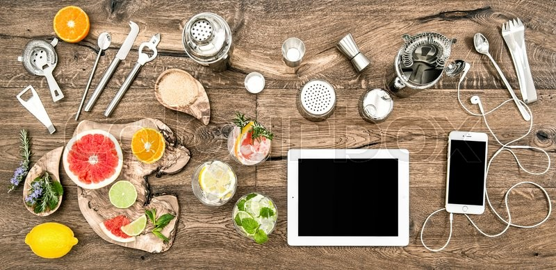 Kitchen table with bar tools, accessories and electronic devices. Flat lay background, stock photo