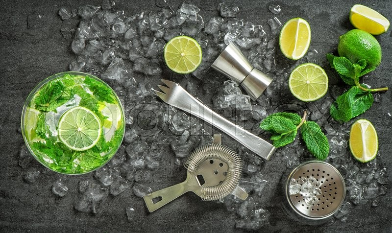 Stock image of 'Cocktail drink making tools and ingredients. Cold drink. Mojito. Caipirinha. Vibrant colors'