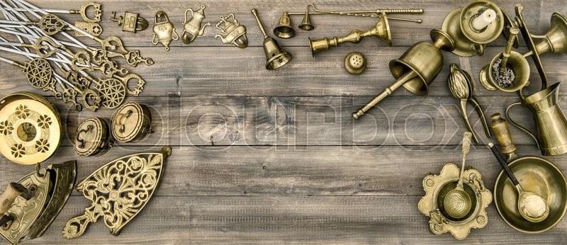 Stock image of 'Kitchen table with antique tools and utensils. Vintage brass table ware'