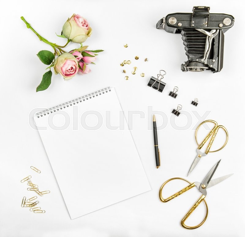 Stock image of 'Flat lay with photo album, flowers, vintage camera, scissors on white background. Mock up'