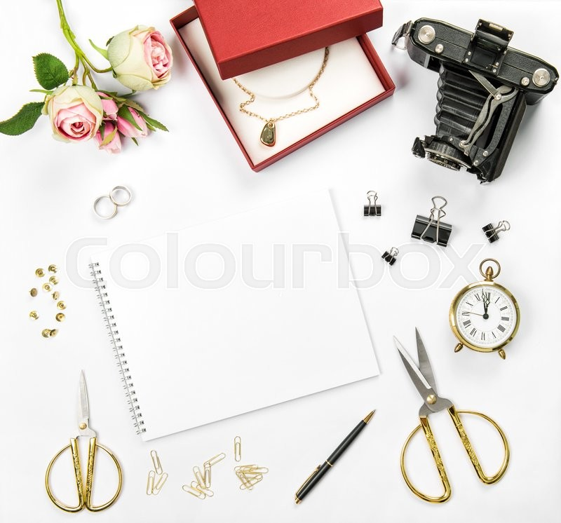 Stock image of 'Wedding flat lay background with gift box, golden rings and flowers'
