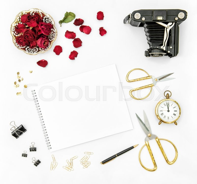 Stock image of 'Flat lay background with red roses flowers, vintage photo camera and golden accessories'