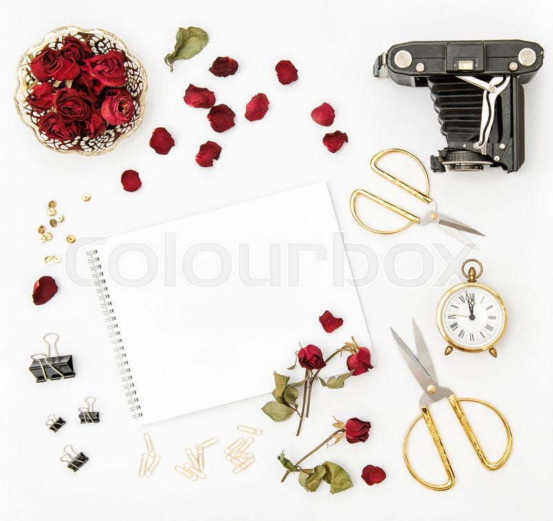 Stock image of 'Flat lay with photo album, red rose petals, vintage camera, scissors on white background. Mock up sketchbook flowers'