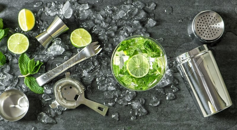 Stock image of 'Summer drink mojito with lime, mint and ice. Top view. Glass of cocktail. '