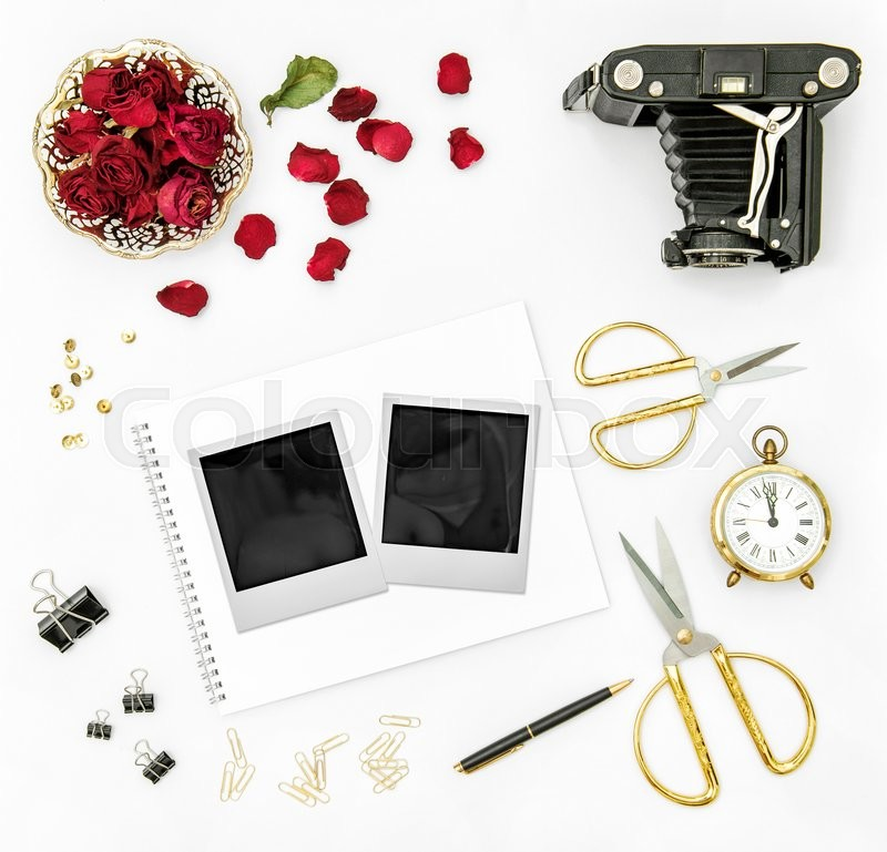 Stock image of 'Red roses flower petals, vintage camera and photo frames. Flat lay background'