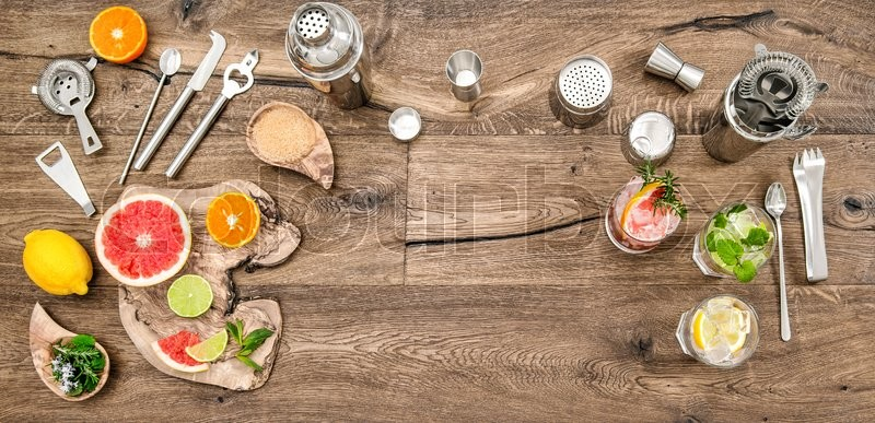 Stock image of 'Alcoholic and nonalcoholic drinks with ice. Cocktail making bar tools, shaker, glasses. Flat lay.Top view'