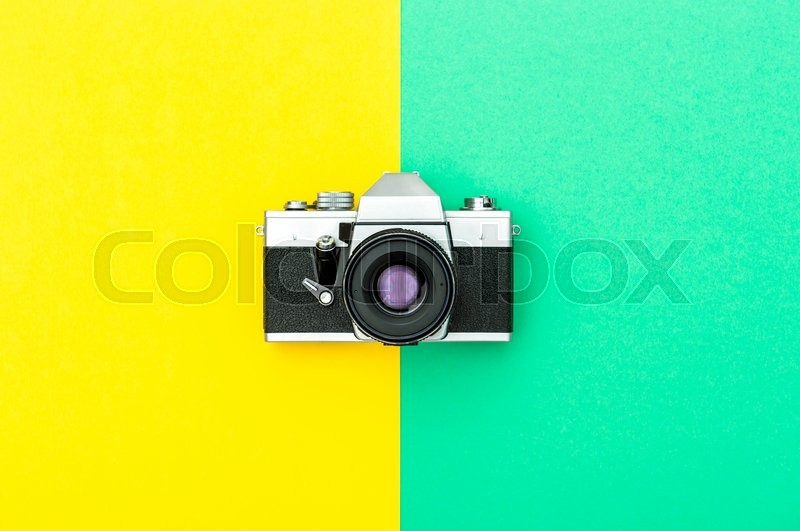Stock image of 'Vintage camera on color hipster background. Instagram style toned picture. Minimal concept'