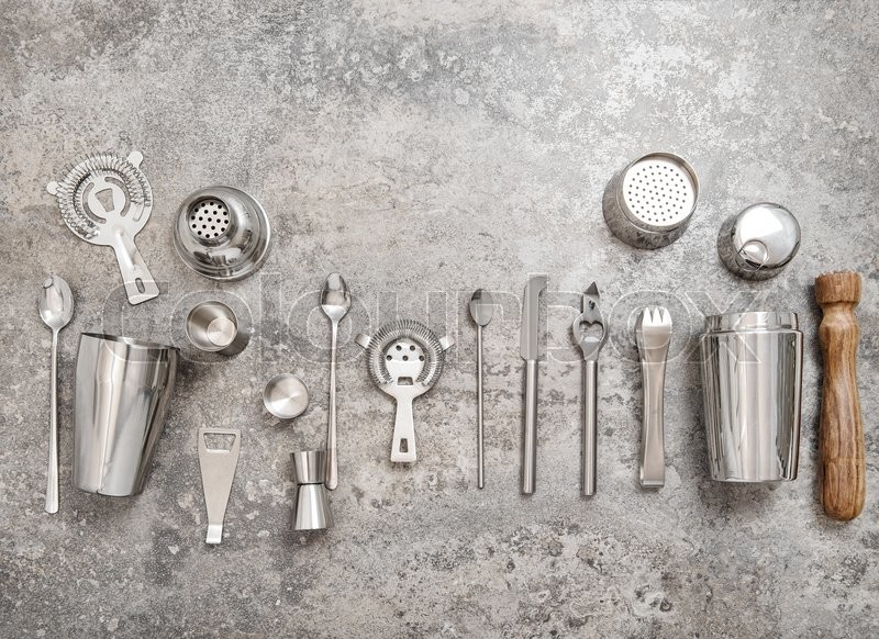 Stock image of 'Bar tools for making cocktail. Shaker, jigger, strainer, spoon. Food and beverages concept'