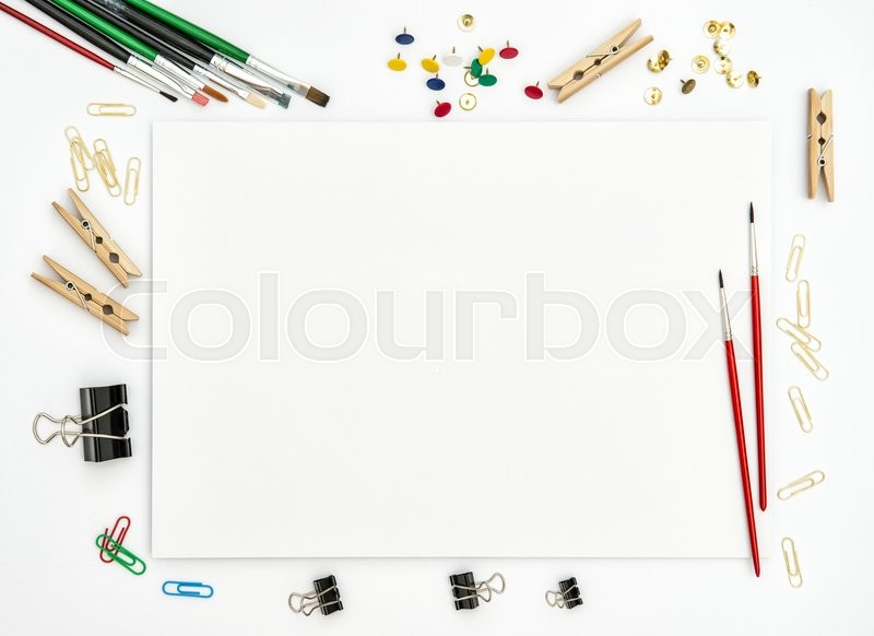 Stock image of 'Flat lay with sketchbook, brushes, paper, office supplies on white background. Top view'
