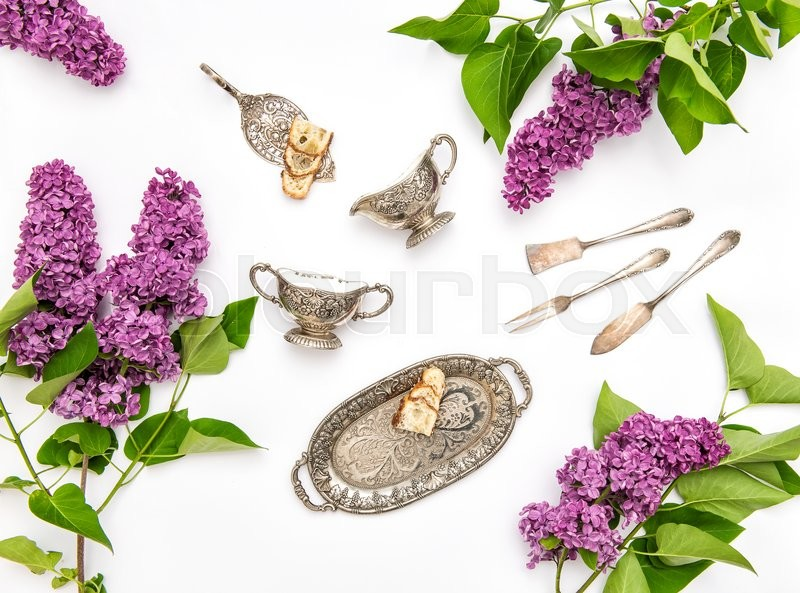 Stock image of 'Lilac flowers. Coffee tea cake objects. Flat lay background'
