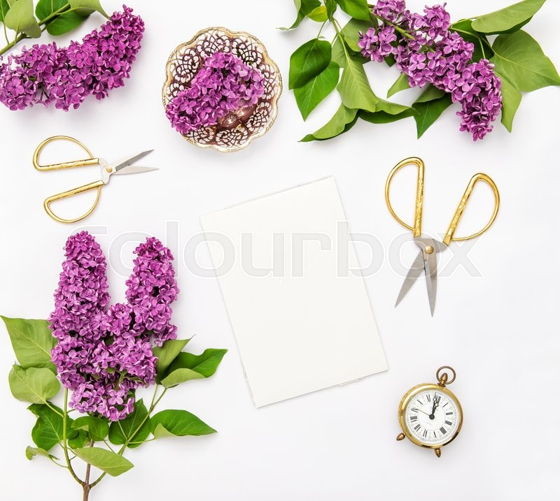 Stock image of 'Sketchbook, lilac flowers, office tools and accessories. Flat lay notebook, top view'