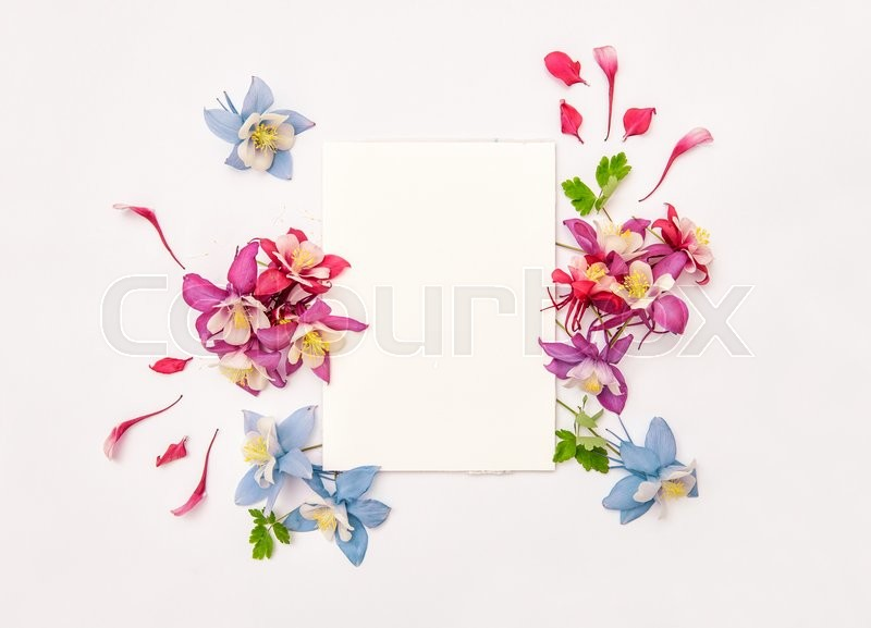 Stock image of 'Columbines flower wreath with empty skatchbook. Flat lay background'
