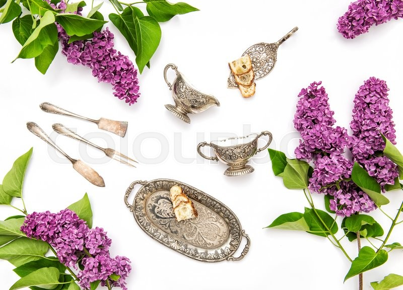 Stock image of 'Lilac flowers. Coffee tea pie table dishes. Flat lay background. Top view'