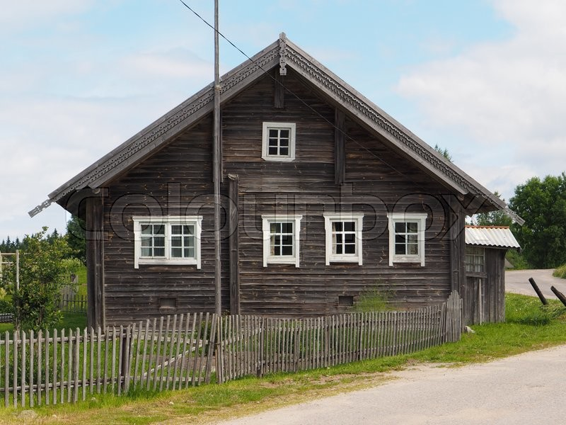 Stock image of 'Old wooden house in village'