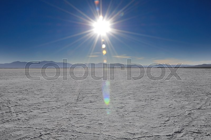 Stock image of 'Sun above salt desert in Jujuy province. Northern Argentina.'