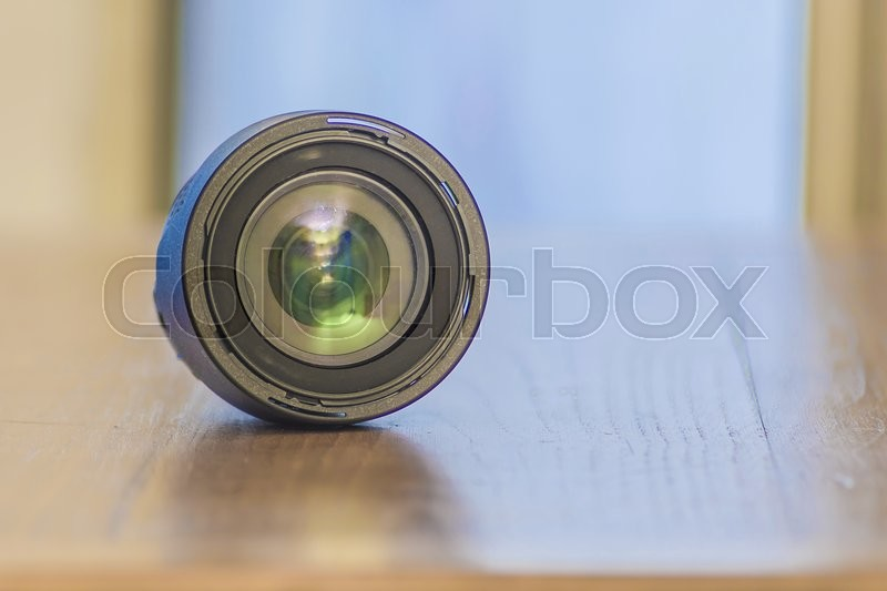 Stock image of 'photo lens on a wood plain'