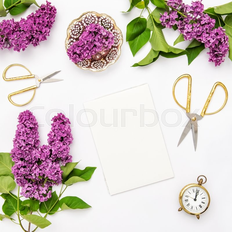 Stock image of 'Lilac flowers, notebook, golden accessories. Flat lay sketchbook, top view'